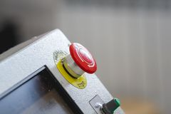 Red emergency stop switch reset button on machinery industry. Close up royalty free stock images