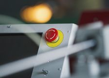 Red emergency stop switch reset button on machinery industry. Close up Stock Photo
