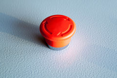 Red emergency stop switch reset industrial button. On blue steel panel Royalty Free Stock Photography