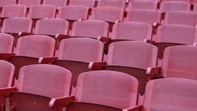 Red empty chairs in the stadium Royalty Free Stock Photos