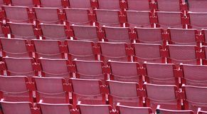 Red empty chairs in the stadium. Before the show Stock Photography