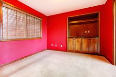 Red empty room with window and buil in cabinet. Stock Photos