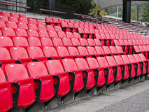 Red empty seats in stadium Royalty Free Stock Photography