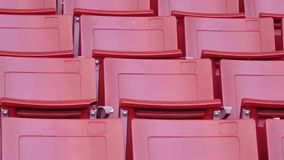Red empty seats in stadium stock video