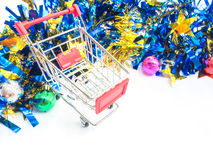 Red empty shopping cart with party ornament Royalty Free Stock Photo