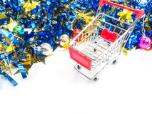 Red empty shopping cart with party ornament Stock Image