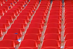 Red empty stadium seats. Rows of red empty stadium seats Royalty Free Stock Image