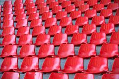 Red empty stadium seats in arena. Old and dirty  concept Royalty Free Stock Photo