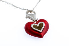 Red enamel heart necklace Royalty Free Stock Images