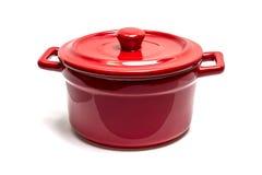 Red enamel pot. On a white background royalty free stock photos
