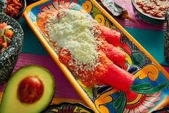 Red enchiladas Mexican food with guacamole Royalty Free Stock Image