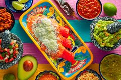 Red enchiladas Mexican food with guacamole Royalty Free Stock Images