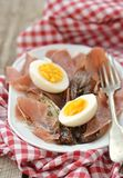 Red endive ,eggs and warm salad Royalty Free Stock Image