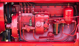 Red engine on old tractor Royalty Free Stock Photography
