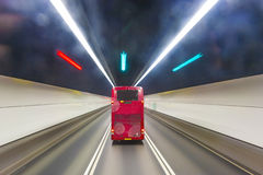 Red english bus in a tunnel Stock Image