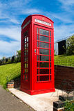 Red english phone box. In a UK village Royalty Free Stock Photo