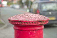 Red English pillar box or post box top on city space background. Royalty Free Stock Photos