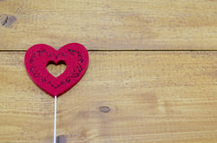Red engraved heart on a table Royalty Free Stock Photo