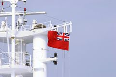 Red Ensign. A Red Ensign flying from a masthead royalty free stock photo