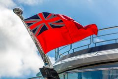 Red Ensign Flag on Yacht. The Red Ensign Flag on on a Luxury Yacht stock photos