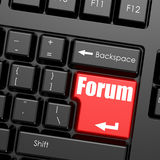 Red enter button on computer keyboard, Forum word Stock Photo