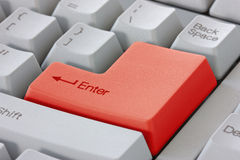 Red enter button on keyboard Stock Photography