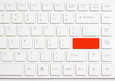 Red enter button on white  computer keyboard Royalty Free Stock Images