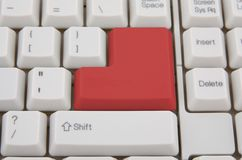 Red Enter key. Computer keyboard with red Enter key, business concept Stock Image