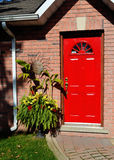 Red entrance door of a house. royalty free stock photography