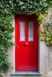 Red Entrance Door with jasmine flowers Royalty Free Stock Photo