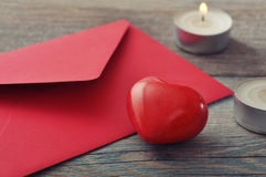 Red envelop with stone heart Stock Photography