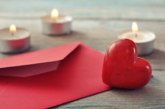 Red envelop with stone heart Stock Photos