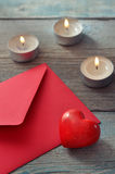 Red envelop with stone heart Royalty Free Stock Photo