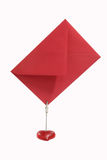 Red Envelope. Postit clip holder with red Envelope on white Background Royalty Free Stock Photo