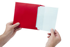 Red Envelope With Blank Sheet. Great shot of a man holding a red envelope with a blank sheet coming out of it.  Perfect shot to use for a Valentine idea or Royalty Free Stock Photos