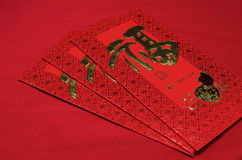 Red Envelope in Chinese new year festival on red background. Stock Photos