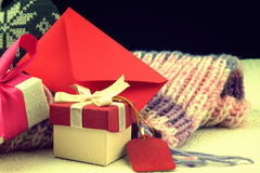 Red envelope, christmas gift boxes and winter scarf Stock Images