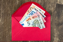 Red envelope with Euro bills. Royalty Free Stock Photo