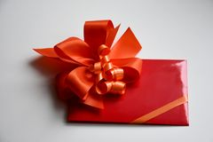 Gift voucher with red bow. Red envelope with gift voucher for birthday valentine christmas or surprise gift stock photos