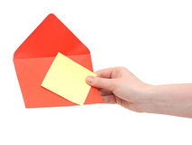Red envelope in the hand Stock Photos