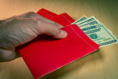 The red envelope or hong bao is used for giving money during Chinese New Year in China and Taiwan Stock Images