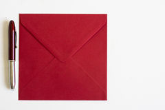 Red Envelope and pen on isolated background Royalty Free Stock Photography