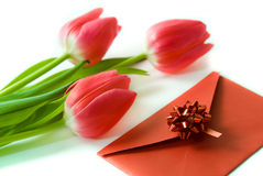 Red envelope and red tulips Stock Photography