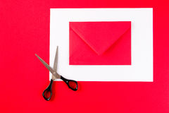 A red envelope with scissors Royalty Free Stock Photos