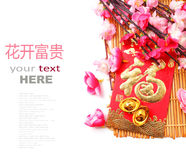 Red Envelope, Shoe-shaped gold ingot (Yuan Bao) and Plum Flowers. Red packet (with Chinese character fu means fortune) shoe-shaped gold ingot and Plum Flowers Royalty Free Stock Photo