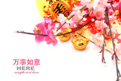 Red Envelope, Shoe-shaped gold ingot (Yuan Bao) and Plum Flowers Royalty Free Stock Photography
