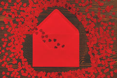 Red envelope and small hearts Royalty Free Stock Image