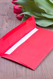 Red envelope with tulips Royalty Free Stock Photos