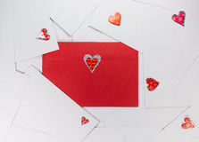 Red envelope between white ones.  Stock Photography