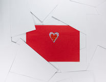 Red envelope between white ones.  Royalty Free Stock Images